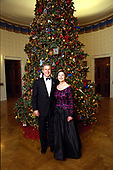 United States President George W. Bush and first lady Laura Bush stand in front of the Blue Room Christmas Tree in the White House in Washington, DC on Sunday, December 8, 2002 prior to hosting a reception for the Kennedy Center Honorees. Mrs. Bush is wearing a floor length gown designed by Arnold Scaasi. <br /> Mandatory Credit: Eric Draper / White House via CNP
