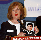 Washington, D.C. - June 29, 2005 --  Mary Fatchett holds a photo of her son, Brad, who perished in the World Trade Center on September 11, 2001, speaks at a press conference in Washington, D.C. on June 29, 2005.   Ms. Fatchett, a member of the Coalition of 9/11 Families, is in Washington to lobby against the International Freedom Center (IFC).<br /> Credit: Ron Sachs / CNP