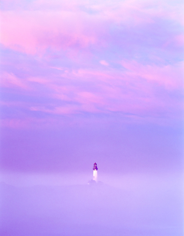 Yaquina Lighthouse, fog and sunrise. Oregon.