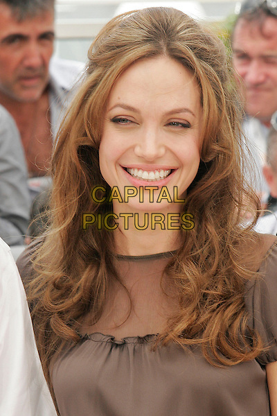 "ANGELINA JOLIE.""A Mighty Heart"" photocall at the 60th International Cannes Film Festival, Cannes, France. .May 21st, 2007.portrait headshot brown smiling wrinkles crow's feet laugh lines .CAP/DAR.©Darwin/Capital Pictures"