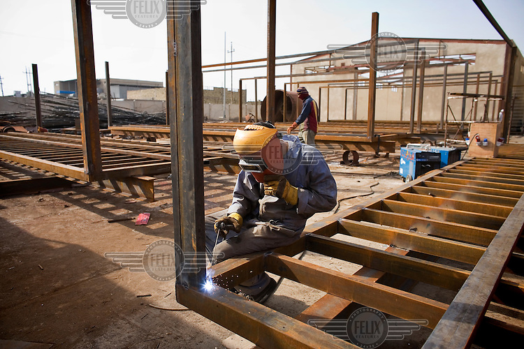 A worker at IBN Majid, the largest state owned Steel and Engineering Company in Basra.
