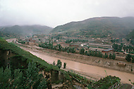 September, 1985. Shaanxi Province, China. The town of Wuqi on the Luo River, once of the poorest in China. Fifty years ago Wuqi was a village with only 7 families, and has grown into a town of 4000 people with shops, schools and electric lights.
