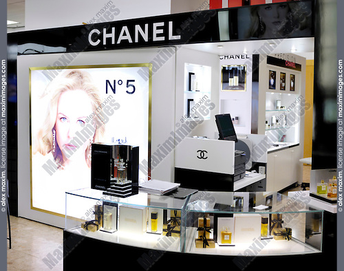Chanel cosmetics and makeup illuminated display in a shopping mall in Toronto Canada