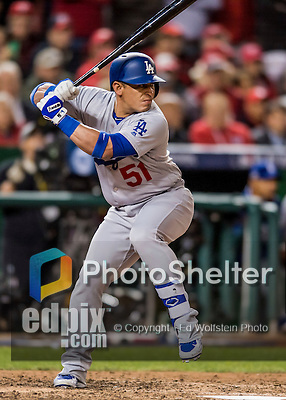 13 October 2016: Los Angeles Dodgers catcher Carlos Ruiz at bat during the NLDS Game 5 against the Washington Nationals at Nationals Park in Washington, DC. The Dodgers edged out the Nationals 4-3, to take Game 5, and the Series, 3 games to 2, moving on to the National League Championship against the Chicago Cubs. Mandatory Credit: Ed Wolfstein Photo *** RAW (NEF) Image File Available ***