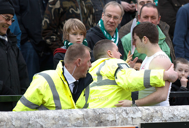 Hibs fan in a tutu and Jedward mask running across the pitch at half time and vaults the wall anly to be grabbed by the fuzz