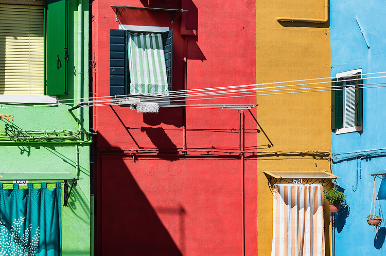Colorful home facades in the Venetian fishing village island of Burano, Italy