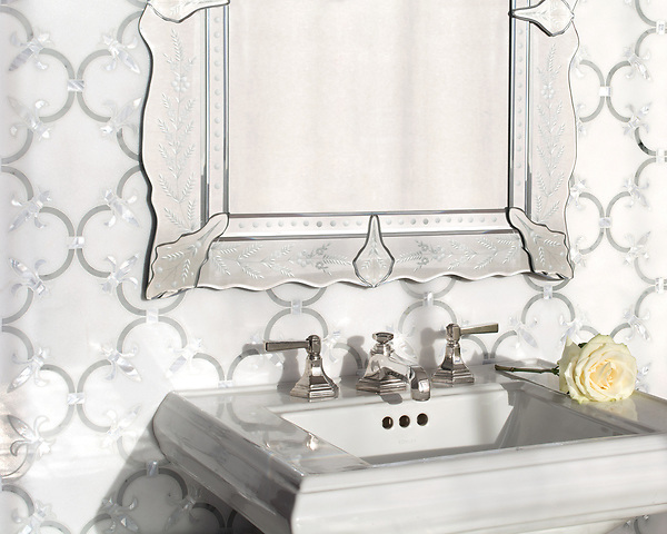 Fleur De Lys, a waterjet stone mosaic, shown in polished Thassos, polished Carrara, and Shell, is part of the Jardin Collection by Caroline Beaupere for New Ravenna.