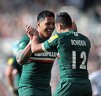 Manu Tuilagi celebrates with Dan Bowden after the latter scores a try. Aviva Premiership match, between Leicester Tigers and Newcastle Falcons on September 21, 2013 at Welford Road in Leicester, England. Photo by: Patrick Khachfe / JMP