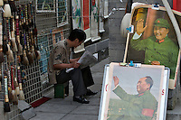 Liulichang art and antiquities street. Chairman Mao posters.