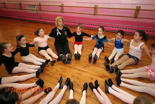 Sophia Salem 8 of Telford, Pa., (in red shorts) is on her instructor's, Jane Lopoten's left, at the Jane Lopten School of Dance in Landsdale, Pa. on Friday March 3, 2006. All the Salem children are involved in physical activities of some sort or the other. It improves the childrens bones due to a lack proper nutrition in utero and diet growing up. While still in the orphanage at 10 months, Sophia would wrestle a bottle of milk away from other babies and give it to her twin brother Joseph, that act in fact, kept Joseph alive. The Salem children, 3 sets of twins, are from Russia. Sophia and twin Joseph were adopted at 11 months of age by Hythem and his wife Lisa. The other twins, Selene and Julianne 13 along with Sam and Jake, were adopted just 20 months ago. All children are thriving in school, socially and physically. photo by jane therese