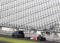 Jul 12, 2020; Clermont, Indiana, USA; The dragster of NHRA top fuel driver Doug Kalitta is towed in front of empty grandstands during the E3 Spark Plugs Nationals at Lucas Oil Raceway. This is the first race back for NHRA since the start of the COVID-19 global pandemic. Mandatory Credit: Mark J. Rebilas-USA TODAY Sports