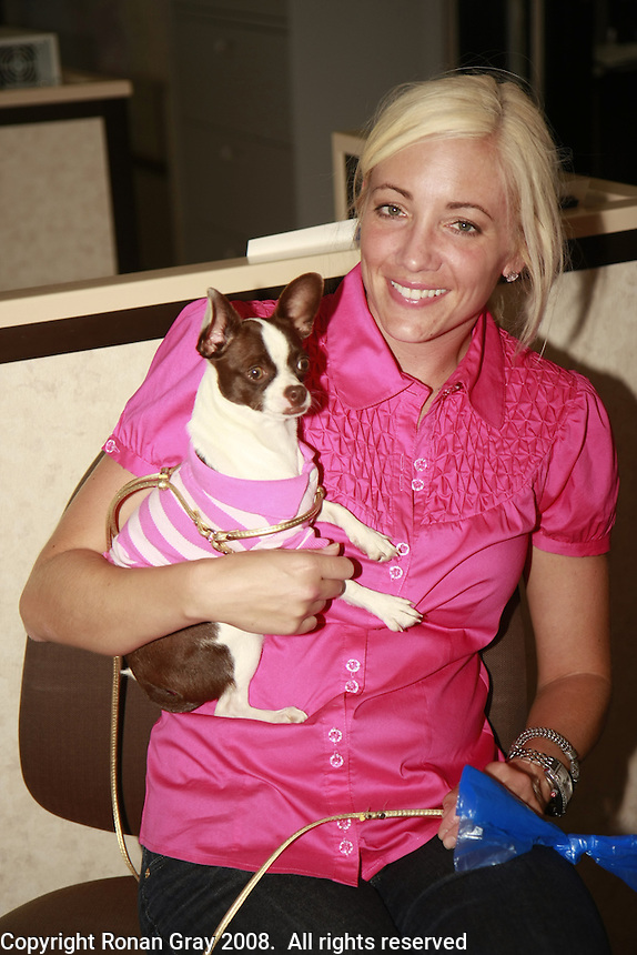 "Friday, June 20, 2008 was take your dog to work day at Caldwell Banker in Mission Beach, California USA.  Nicole Simpson and ""Bella""."