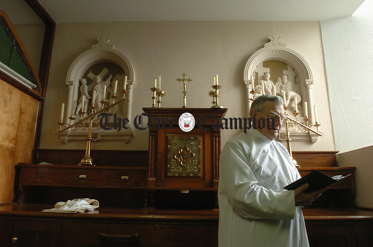 With Story..................Canon Mullin,  of Miltown Malbay and Moy prepares for his last mass as parish Priest, in the sacristy of St Joseph's church in Miltown Malbay.  Photograph by John Kelly.