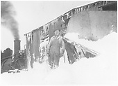 Leased D&amp;RGW K-27 #462 with RGS plow-flanger #02 in snow with two workmen beside plow.<br /> RGS
