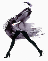 Fashion model striding in flowing coat