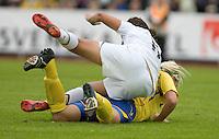 Carli Lloyd falls over a Swedish player during the match against Sweden, Landskamp, Sweden, July 5th, 2008.