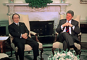 United States President Bill Clinton meets Minister for Foreign Affairs Michio Watanabe of Japan in the Oval Office of the White House in Washington, DC on February 11, 1993.<br /> Credit: Howard L.  Sachs / CNP