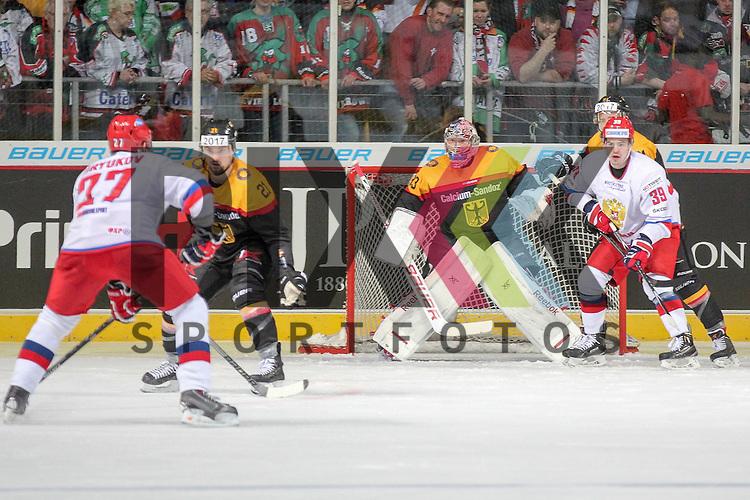 Russlands Biryukov Yevgeni Nikolayevich (Nr.)(Metallurg Magnitogorsk) mit dem Puck vor dem Tor von Deutschlands Aus den Birken, Danny (Nr.33)(Koelner Haie) gest&ouml;rt von Russlands Antipin Viktor Vladimirovich (Nr.39)(Metallurg Magnitogorsk) im Spiel IIHF WC15 Germany - Russia.<br /> <br /> Foto &copy; P-I-X.org *** Foto ist honorarpflichtig! *** Auf Anfrage in hoeherer Qualitaet/Aufloesung. Belegexemplar erbeten. Veroeffentlichung ausschliesslich fuer journalistisch-publizistische Zwecke. For editorial use only.