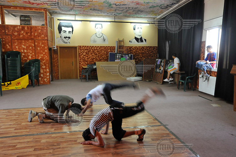 A breakdancing lesson at the Ibdaa Centre in the Deheisheh refugee camp. Ibdaa, which means 'to create something out of nothing' in Arabic, is a grassroots initiative run by the Dheisheh Refugee Camp. Its aim is to provide a safe environment for the camp's children, youth, and women to develop a range of skills, creatively express themselves, and build leadership through cultural, educational, and social activities that are not readily available in either the camp or occupied Palestine.