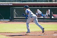 Surprise Saguaros designated hitter Vladimir Guerrero Jr. (27), of the Toronto Blue Jays organization, runs to first base during an Arizona Fall League game against the Scottsdale Scorpions at Scottsdale Stadium on October 26, 2018 in Scottsdale, Arizona. Surprise defeated Scottsdale 3-1. (Zachary Lucy/Four Seam Images)