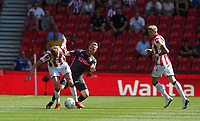 Stoke City's Sam Clucas is tackled by Leeds United's Adam Forshaw<br /> <br /> Photographer Stephen White/CameraSport<br /> <br /> The Premier League - Stoke City v Leeds United - Saturday August 24th 2019 - bet365 Stadium - Stoke-on-Trent<br /> <br /> World Copyright © 2019 CameraSport. All rights reserved. 43 Linden Ave. Countesthorpe. Leicester. England. LE8 5PG - Tel: +44 (0) 116 277 4147 - admin@camerasport.com - www.camerasport.com