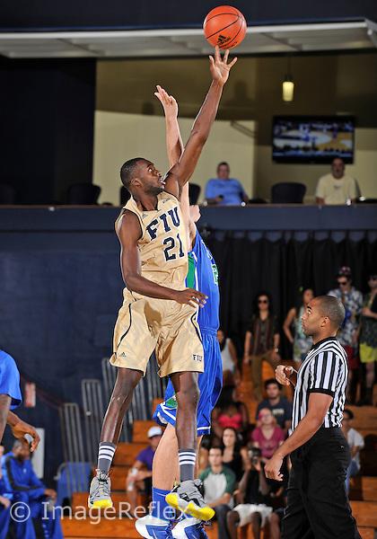 Florida International University forward Rakeem Buckles (21) plays against Florida Gulf Coast University.  FIU won the game 72-61 on December 7, 2013 at Miami, Florida.