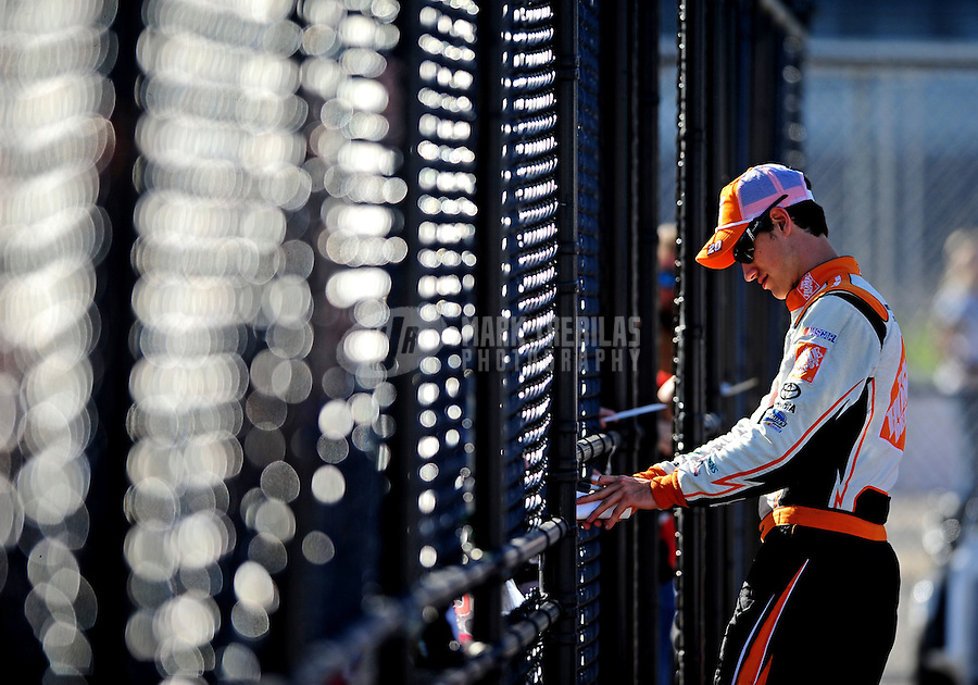 Oct. 1, 2010; Kansas City, KS, USA; NASCAR Sprint Cup Series driver Joey Logano signs autographs during qualifying for the Price Chopper 400 at Kansas Speedway. Mandatory Credit: Mark J. Rebilas-