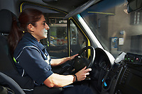 Switzerland. Canton Ticino. Lugano. Day scene for a medical emergency intervention. A paramedic drives with hands on steering wheel and rushes the ambulance to the hospital. The woman wears a blue uniform and works for the Croce Verde Lugano. The woman is a volunteer specifically trained in emergency rescue. The Croce Verde Lugano is a private organization which ensure health safety by addressing different emergencies services and rescue services. Volunteering is generally considered an altruistic activity where an individual provides services for no financial or social gain to benefit another person, group or organization. Volunteering is also renowned for skill development and is often intended to promote goodness or to improve human quality of life. 13.01.2018 © 2018 Didier Ruef