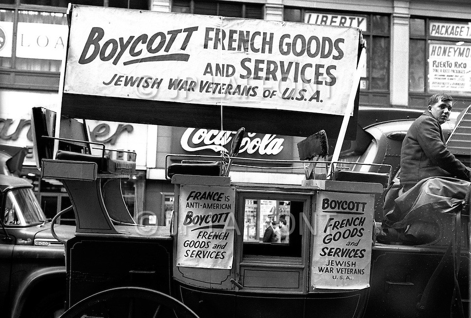 April 1, 1969. Manhattan, NYC. A protestor from the Jewish War Veterans of the United States displays signs on a carriage asking people to boycott French merchandise and services in 1969. The veterans protested France's refusal to deliver military planes to Israel for which French manufacturers had received full payment and they also opposed the sale of French planes to Libya.