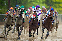 BALTIMORE, MD - MAY 21: Nyquist #3, ridden by Mario Gutierrez, (C) leads the field out of the fourth turn as Exaggerator #5, ridden by Kent J. Desormeaux, (L) overtakes in the the 141st running of the Preakness Stakes at Pimlico Race Course on May 21, 2016 in Baltimore, Maryland. (Photo by Douglas DeFelice/Eclipse Sportswire/Getty Images)