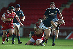 Front row battle as Scarlets prop Phil John tackles Munster hooker Duncan Casey.<br /> Celtic League<br /> Scarlets v Munster<br /> <br /> 01.03.14<br /> <br /> ©Steve Pope-SPORTINGWALES