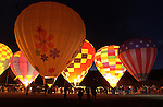 Hot air balloons fire up their burners during the 'glow' event at the Snowmass Balloon Festival. © Michael Brands. 970-379-1885.