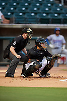Birmingham Barons catcher Alfredo Gonzalez (1) waits to receive a pitch in front of home plate umpire Chase Eade during a game against the Tennessee Smokies on August 16, 2018 at Regions FIeld in Birmingham, Alabama.  Tennessee defeated Birmingham 11-1.  (Mike Janes/Four Seam Images)