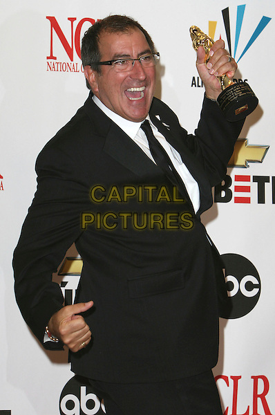 KENNY ORTEGA .2007 NCLR ALMA Awards - Press Room held at the Pasadena Civic Center, Pasadena, California, USA..June 1st, 2007.half length black award trophy glasses suit jacket arm mouth open.CAP/ADM/CH.©Charles Harris/AdMedia/Capital Pictures *** Local Caption *** .