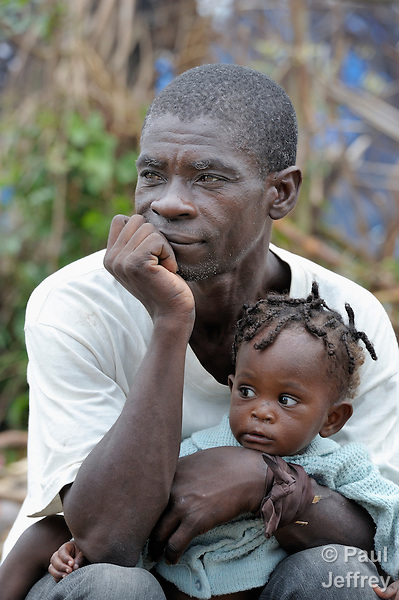 A man and his daughter in a displaced persons camp in Jacmel, a town on Haiti's southern coast that was ravaged by the January 12 earthquake.