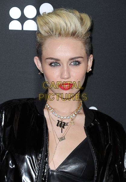 Miley Cyrus<br /> The Myspace Event held at The El Rey Theatre in Los Angeles, California, USA.<br /> June 12th, 2013   <br /> headshot portrait black leather shiny red lipstick necklace gold diamonds  <br /> CAP/DVS<br /> &copy;DVS/Capital Pictures