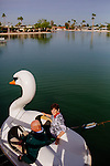 Jeannie and Larry Klein sit in their swan paddle boat at Viewpoint Lake right ouside of their Sun City home December 1, 2013.
