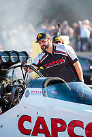 Jul 19, 2019; Morrison, CO, USA; Bobby Lagana, crew member for NHRA top fuel driver Steve Torrence during qualifying for the Mile High Nationals at Bandimere Speedway. Mandatory Credit: Mark J. Rebilas-USA TODAY Sports