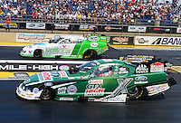 Jul, 22, 2012; Morrison, CO, USA: NHRA funny car driver John Force (near lane) races alongside Jack Beckman during the Mile High Nationals at Bandimere Speedway. Mandatory Credit: Mark J. Rebilas-US PRESSWIRE