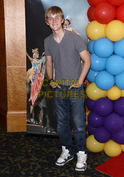 """JASON DOLLEY.Ringling Bros And Barnum & Bailey  presents """"Barnum's FUNundrum""""  held at the Staples Center, Los Angeles, California, USA..July 15th, 2010.full length jeans denim grey gray t-shirt hands in pockets .CAP/ADM/TC.©T. Conrad/AdMedia/Capital Pictures."""