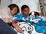 Colin Ader, 5, of Bellmore in Hospital  accompanied by his mother Heather Ader and family friend Karen Saunders in the Pediatirics Unit at South Nassau Communities Hospital on Wednesday April 23, 2008. Photo by Jim Peppler