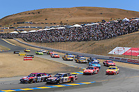 Jun. 21, 2009; Sonoma, CA, USA; NASCAR Sprint Cup Series driver Kyle Busch (18) drives alongside Brian Vickers (83) during the SaveMart 350 at Infineon Raceway. Mandatory Credit: Mark J. Rebilas-