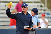 11 February 2012:  FIU Head Coach Jake Schumann exchanges lineups prior to the game.  The University of Louisville Cardinals defeated the FIU Golden Panthers, 4-2, as part of the COMBAT Classic at the FIU Softball Complex in Miami, Florida.