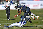 Navy Midshipmen quarterback Keenan Reynolds (19) and Middle Tennessee Blue Raiders cornerback Kenneth Gilstrap (18) in action during the Armed Forces Bowl game between the Middle Tennessee Blue Raiders and the Navy Midshipmen at the Amon G. Carter Stadium in Fort Worth, Texas. Navy defeated Middle Tennessee 24 to 6.