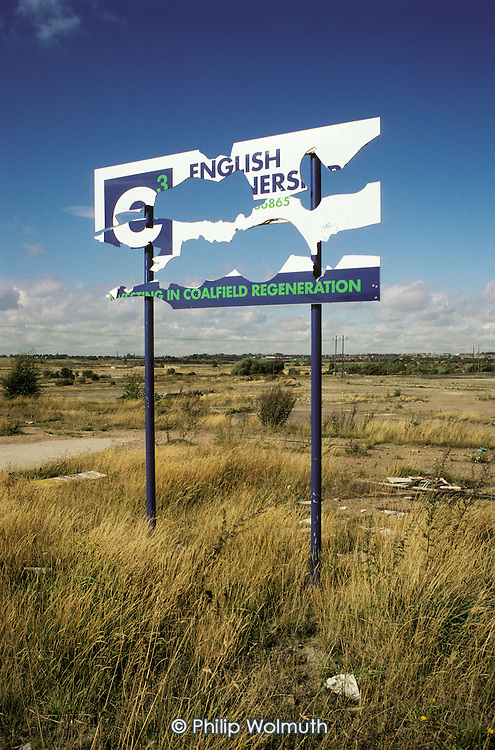 An English Partnership hoarding at the derelict site of the former Grimethorpe colliery in South Yorkshire. The village lost its major sources of employment when the pit closed in 1993, soon followed by the coal-fired power station and the Coalite coking works.