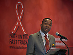 """Ulysses Burley III speaks to the July 21 opening session of """"Faith Building Bridges"""" in Amsterdam, the Netherlands. The July 21-22 interfaith event, sponsored by the World Council of Churches-Ecumenical Advocacy Alliance was held on the eve of the 2018 International AIDS Conference. Burley is chair of the global organizing committee for the interfaith event."""