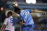 28 August 2016: North Carolina's Tucker Hume (36) heads the ball while having his jersey pulled by Saint Louis's Julian Gieseke (GER) (5). The University of North Carolina Tar Heels hosted the Saint Louis University Billikens at Fetter Field in Chapel Hill, North Carolina in a 2016 NCAA Division I Men's Soccer match. UNC won the game 3-0.