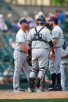 Columbus Clippers manager Chris Tremie (26) talks with relief pitcher TJ House (36) and catcher Guillermo Quiroz (29) during a game against the Rochester Red Wings on June 16, 2016 at Frontier Field in Rochester, New York.  Rochester defeated Columbus 6-2.  (Mike Janes/Four Seam Images)