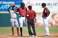 Hickory Crawdads trainer Bronson Santillan (center) and manager Matt Hagan (39) check on Pedro Gonzalez (4) after a play at second base during the game against the Lakewood BlueClaws at L.P. Frans Stadium on April 28, 2019 in Hickory, North Carolina. The Crawdads defeated the BlueClaws 10-3. (Brian Westerholt/Four Seam Images)