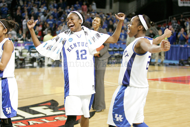 UK's Lydia Watkins (left) and Amani Franklin celebrate their teams victory over Michigan State in the second round of NCAA tournament play at Freedom Hall on Monday, March 22, 2010. Photo by Scott Hannigan | Staff